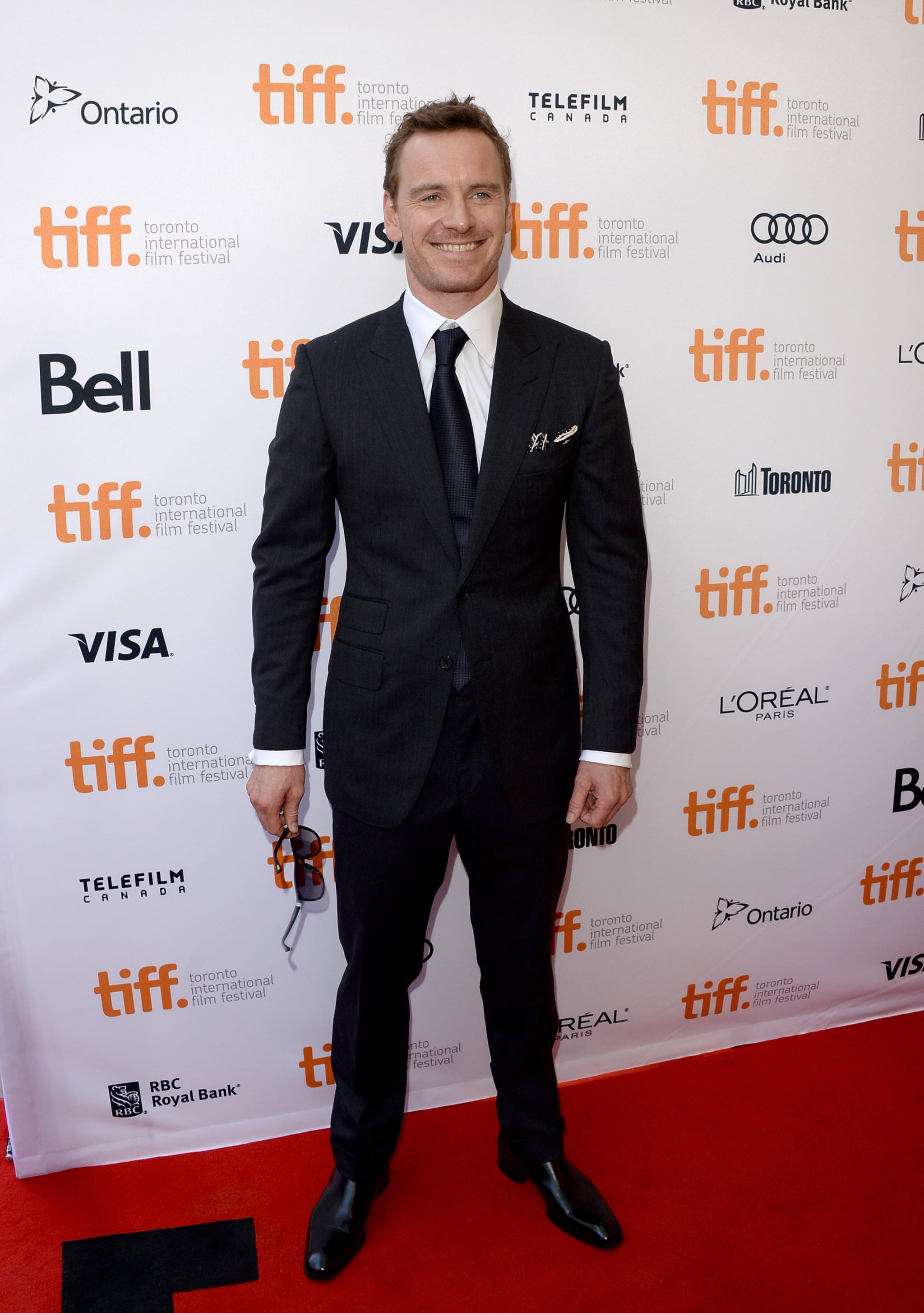 Michael Fassbender sported a suit and a smile at the 12 Years a Slave premiere.