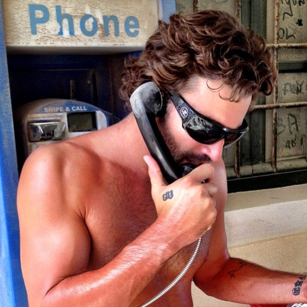 Brody Jenner bared his biceps while talking on a pay phone in Greece. Source: Instagram user brodyjenner