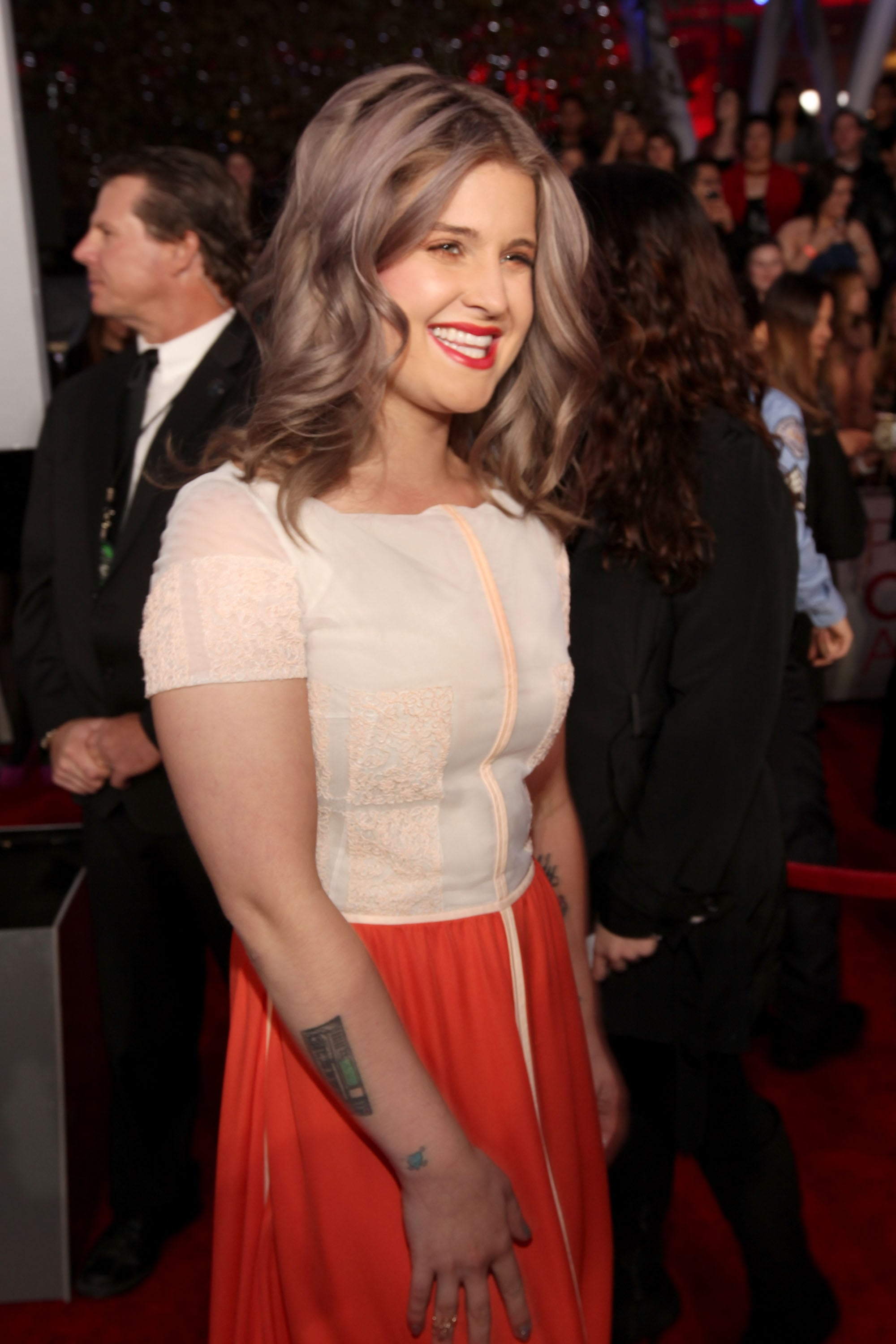 Kelly Osbourne in an orange dress.