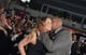 """Mariah Carey got a kiss from Dwayne """"The Rock"""" Johnson at the Hercules premiere in LA on Wednesday."""