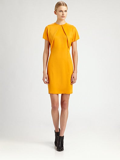 The brilliant color and detailing at the neckline give this understated Acne Sweety pleated sheath dress ($350) a little something extra — translation: this dress is easy to take from work to drinks with the right footwear and a few well-placed jewels.