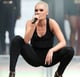 British singer Jessie J showed off her buzzed head and contrasted her white-blond hair color with a dark smoky eye look.