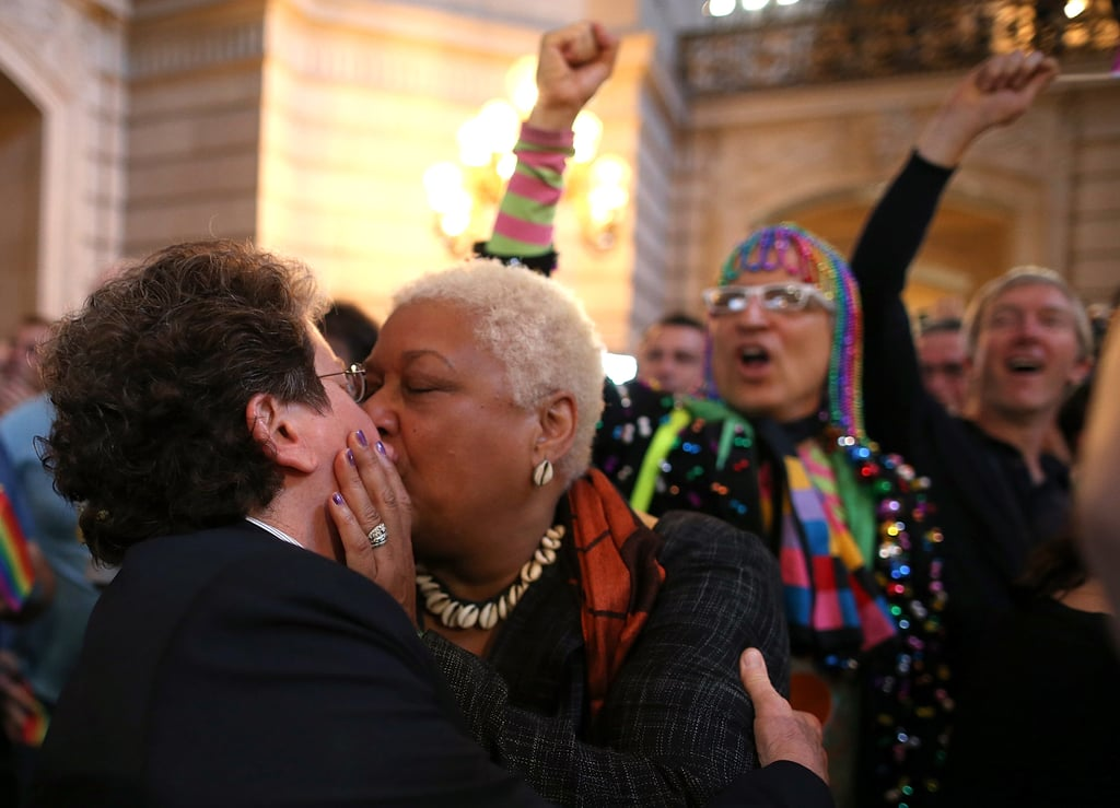 Same-sex couples kissed and embraced after DOMA was ruled unconstitutional.
