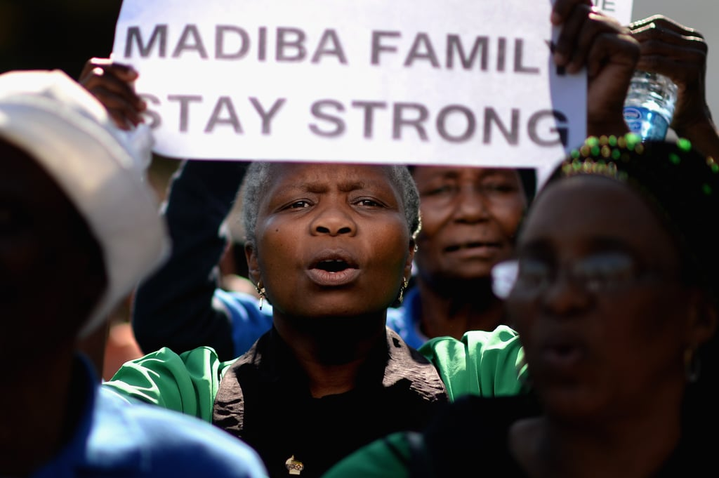 One woman held up a sign in support of Mandela and his family.