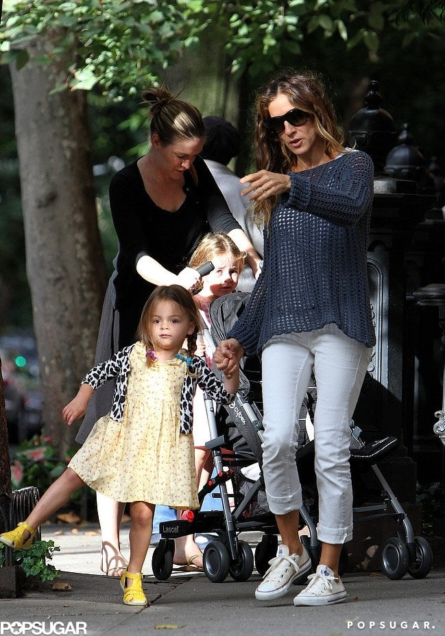 Loretta wore a sweet printed sundress underneath a leopard-spotted cardigan while out for a stroll in September 2012. Her sister, Tabitha, hitched a ride on the back of one of the girls' Cybex strollers.