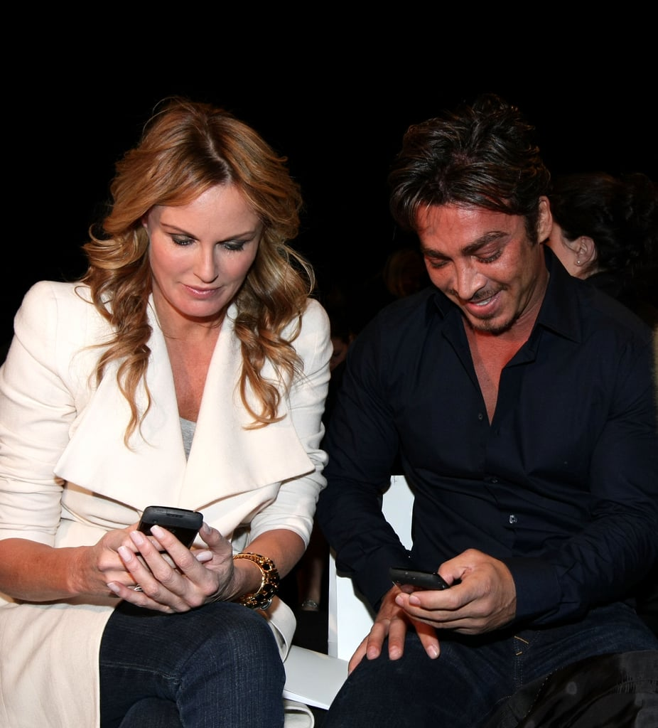 Charlotte Dawson and John Ibrahim checked their phones at Jayson Brunsdon in 2010.
