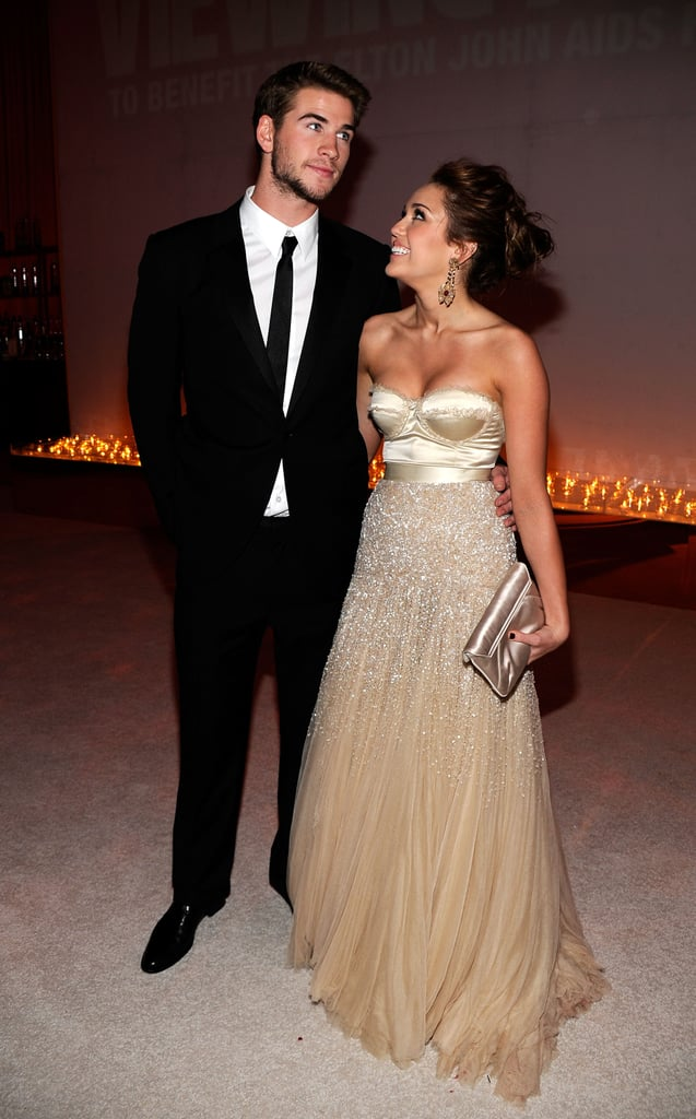 Miley Cyrus and Liam Hemsworth had a look of love at the Elton John AIDS Foundation Academy Award party in March 2010.