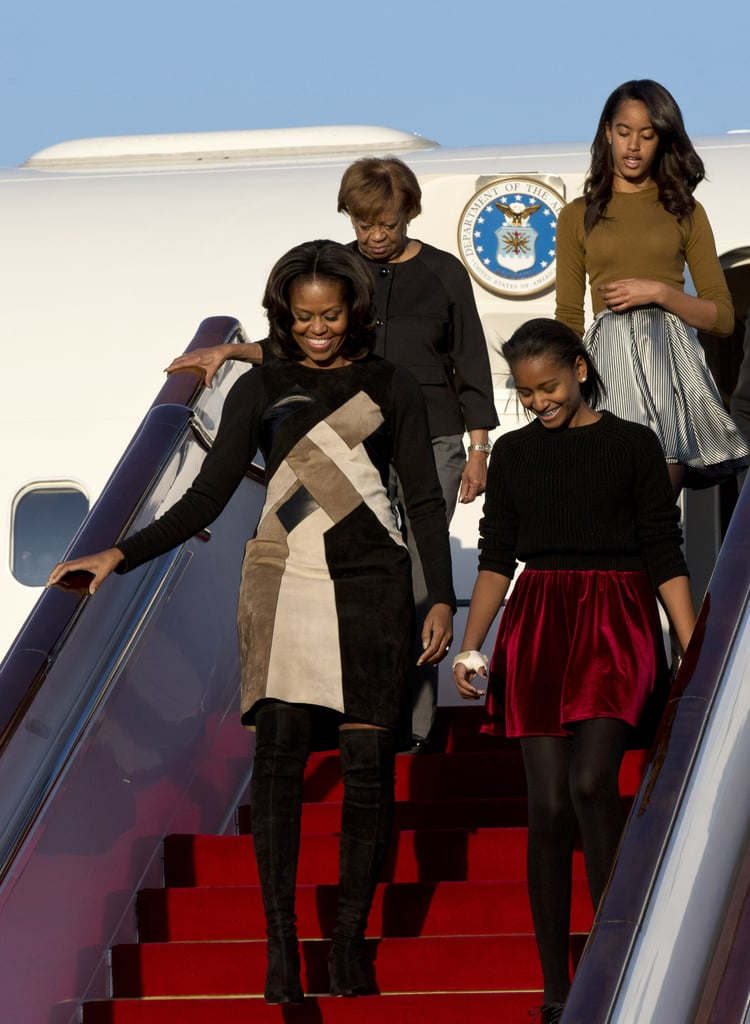 More like air fierce one! The first lady stepped off the plane in Derek Lam's mosaic dress at the Beijing Capital International Airport.