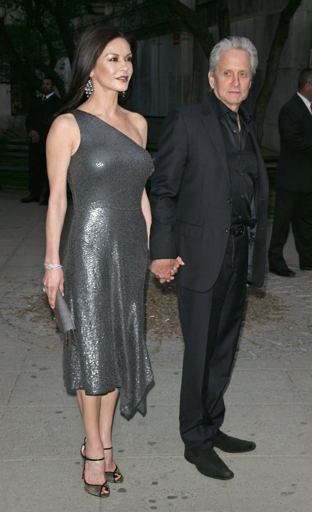 Catherine Zeta-Jones held hands with Michael Douglas on the way into the Vanity Fair Party at the 2012 Tribeca Film Festival.