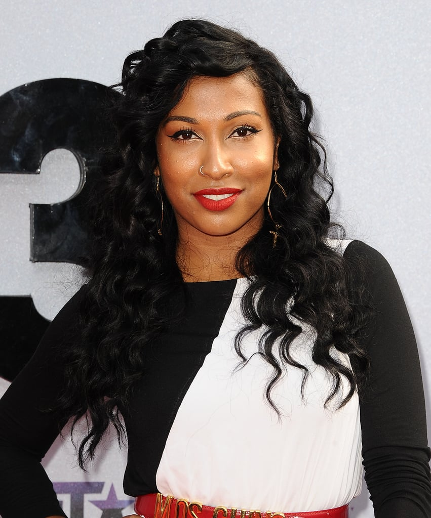 Melanie Fiona wore angular eyeliner and a bright cherry lipstick framed by tight ringlets-turned-waves.
