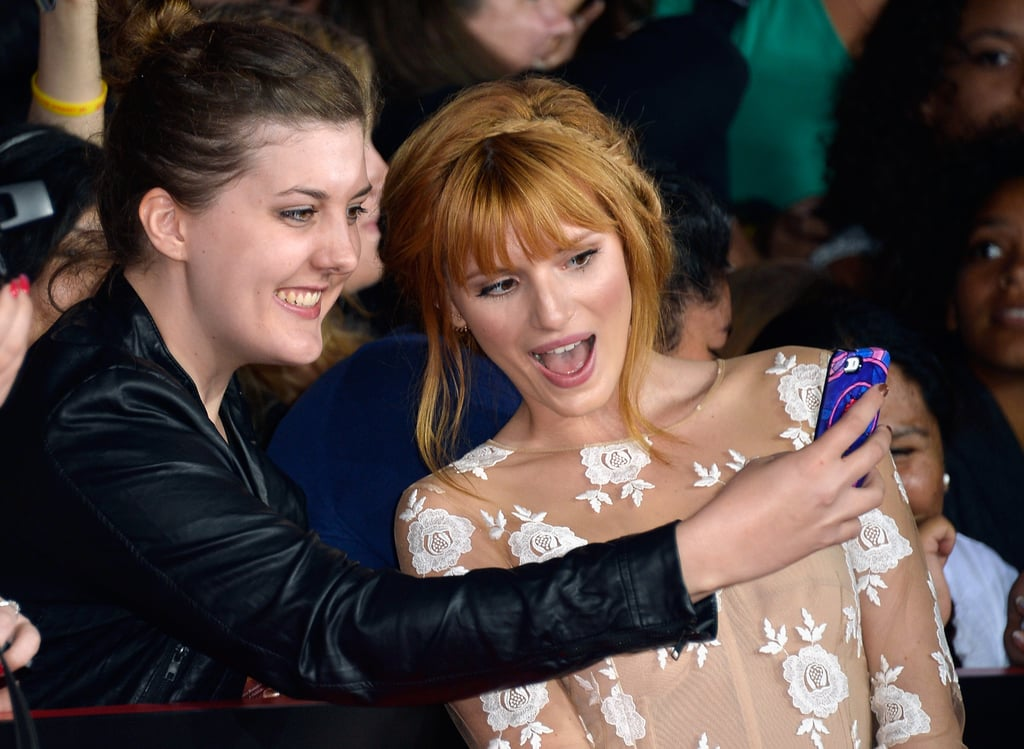 Bella Thorne snapped a pic with a fan.