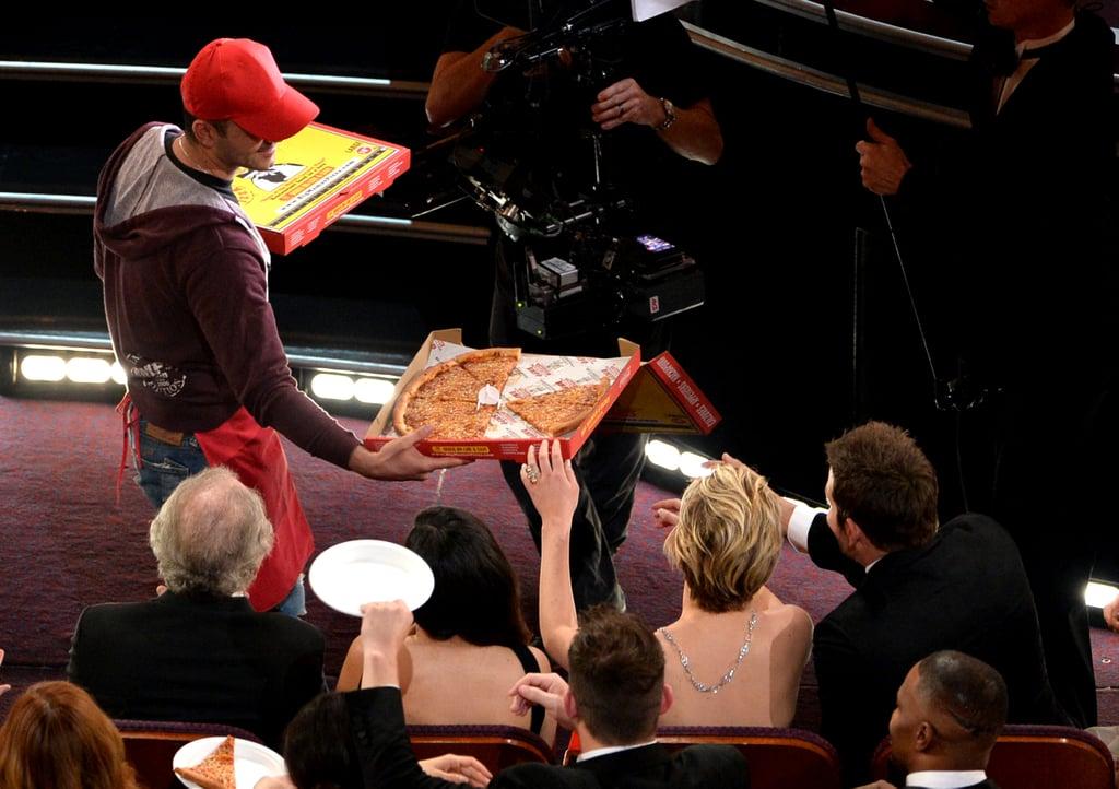 The pizza guy gave Jennifer Lawrence a pizza.