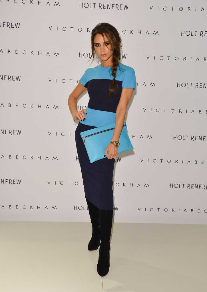 Victoria Beckham wore a dress from her collection to visit Vancouver.