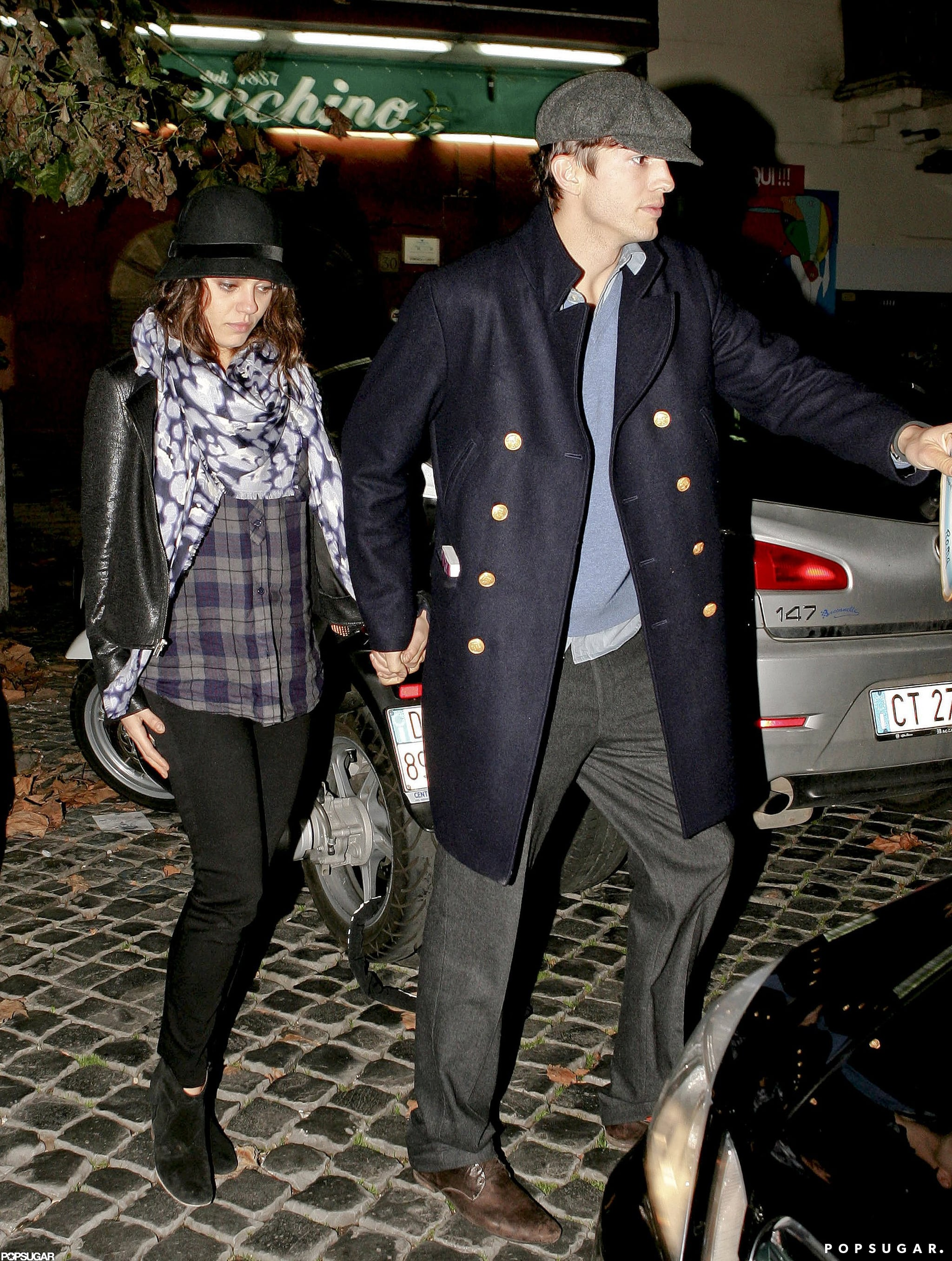 Ashton led the way as he and Mila went to dinner in Rome in November 2012.