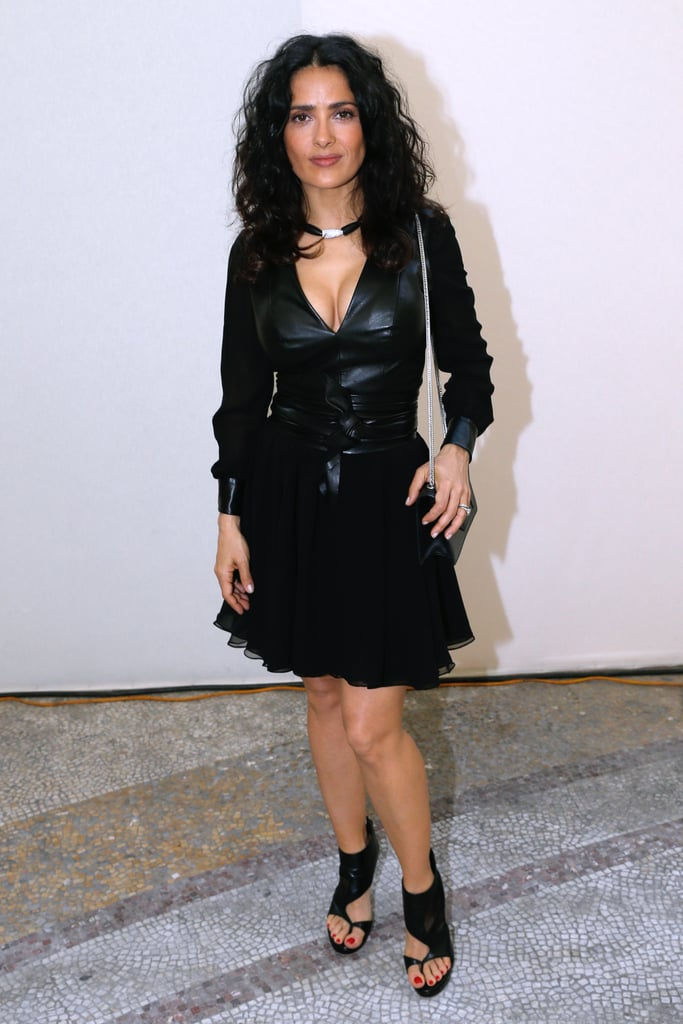 Salma Hayek wore a black leather ensemble to attend Yves Saint Laurent's show on Sunday.