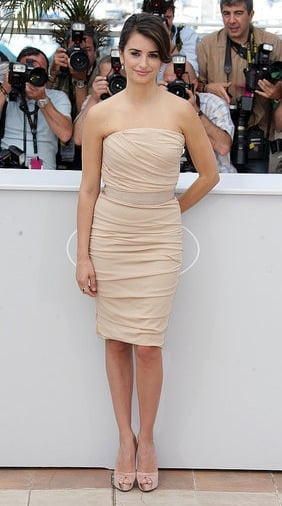 Penelope Cruz at the Cannes Film Festival in Nude Banded Dolce & Gabbana Dress and Nude Satin Louboutin Peep-Toe Pumps