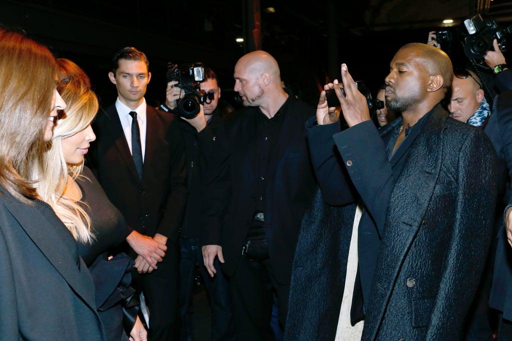 Kanye West took a photo of Kim Kardashian at the Givenchy show on Sunday.