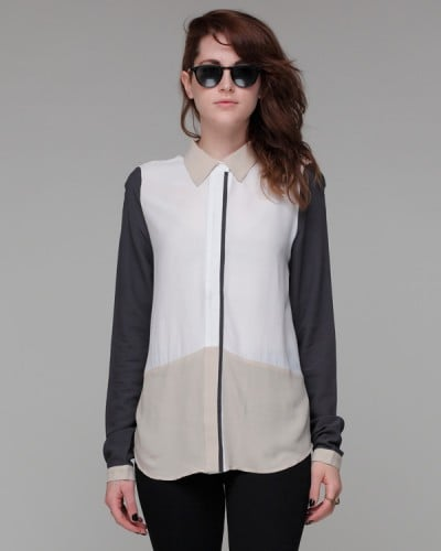 This button-down has a sportier menswear edge that would look fantastic dressed up with a miniskirt to contrast.  Need Supply Alexander Blouse ($62)