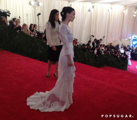 Rooney Mara was first on the carpet, posing for pictures in her custom Givenchy.