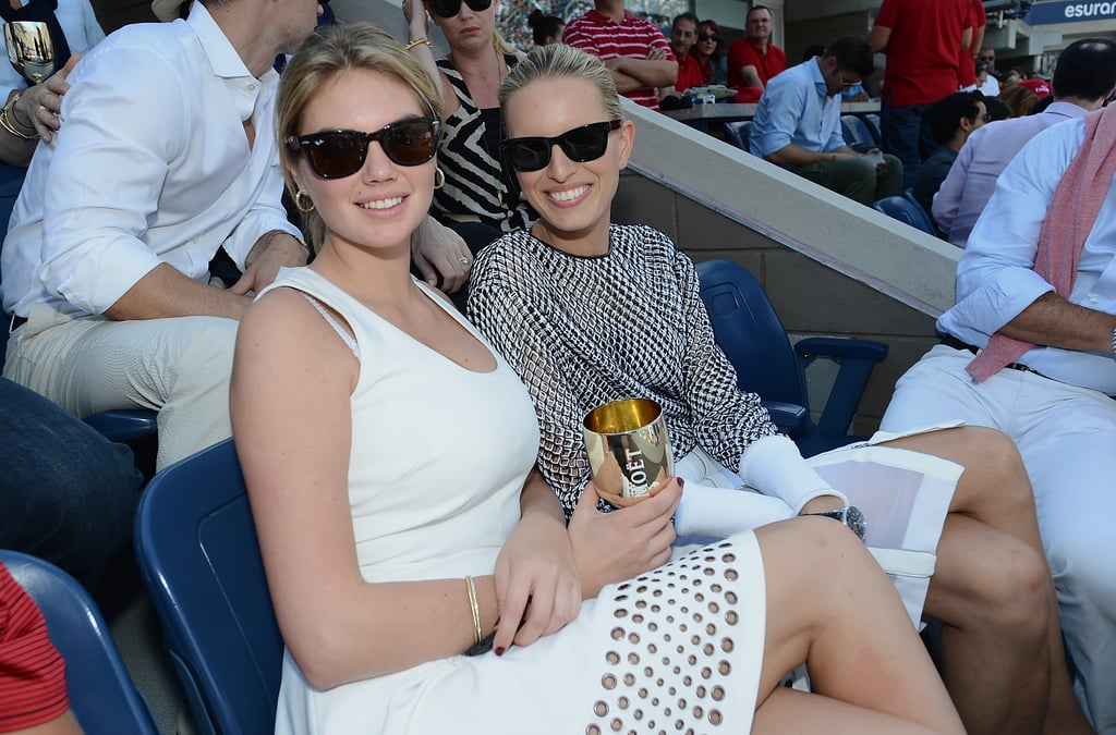 Models Kate Upton and Karolina Kurkova were all smiles while sitting together in the stands.