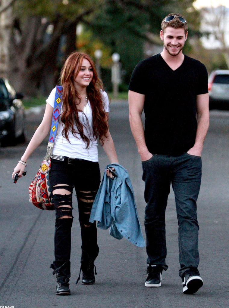Liam Hemsworth and Miley Cyrus smiled as they headed to a friend's LA house to watch the Super Bowl in February 2010.
