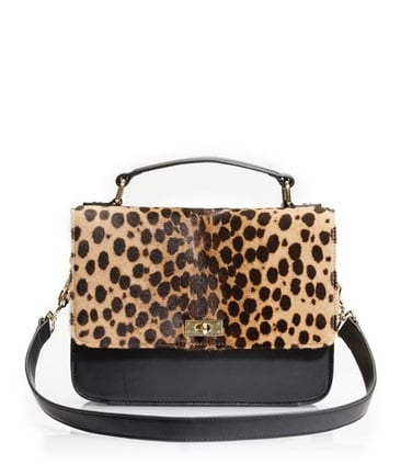 """This purse is so fierce! A two-tone bag is such a versatile piece to have in your wardrobe, and I think my associate producer Liza would rock this bag with a bevy of stylish ensembles!"" — Allison McNamara, FabSugarTV host and producer  J.Crew Edie Purse ($448)"