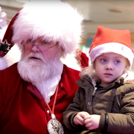 Santa Signs to Little Girl