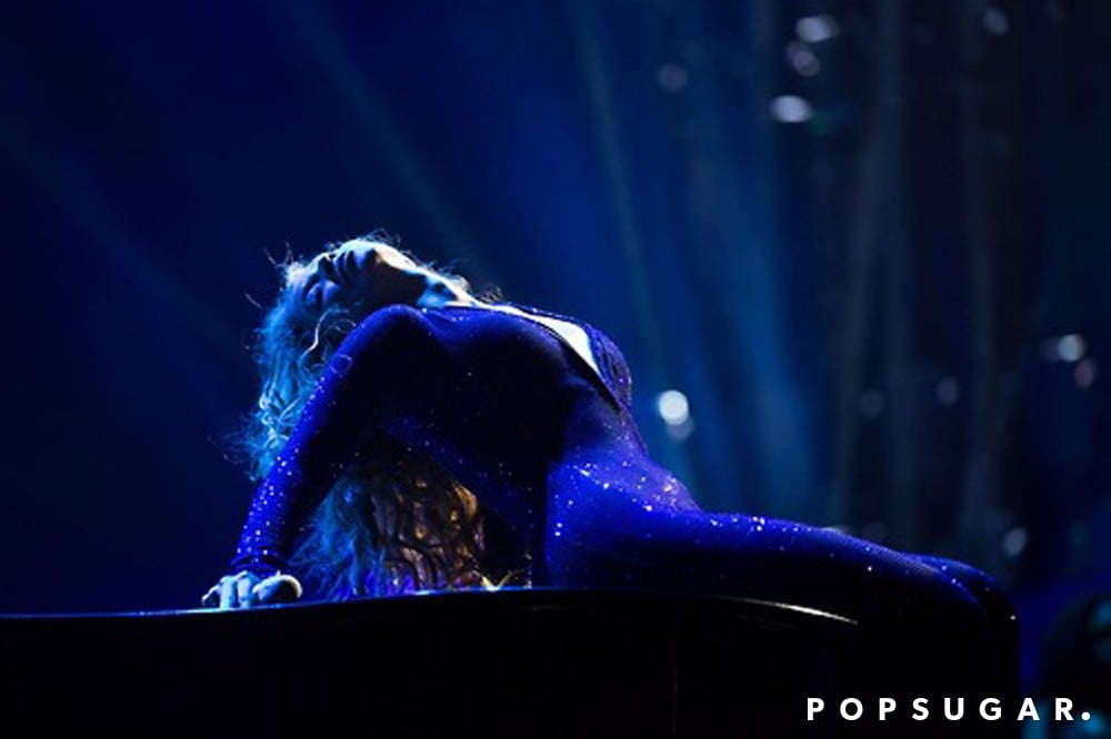 The singer arched her back in her purple sequined jumpsuit.