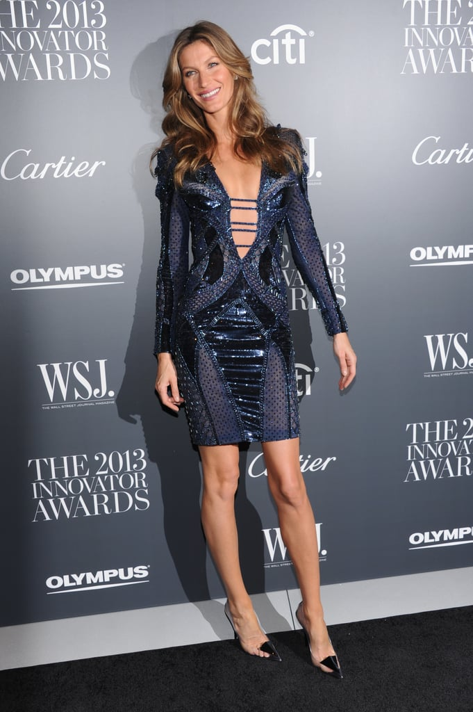 All eyes were on Gisele in this plunging Atelier Versace dress.