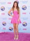 Selena Gomez posed in a high-wattage DSquared2 fit-and-flare and nude Hervé Léger sky-high, ankle-strap stilettos at the 2012 Teen Choice Awards. Where to Wear: An innocent night of drinks and dancing.