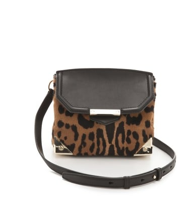 """""""Couple standout leopard print with Wang's ultrasleek silhouette and metallic hardware, and I'm gushing over this little crossbody bag that I already imagine styling out with my go-to army jacket and staying fashionably (and functionally) hands-free all season. For a chic evening twist, I'll tuck in the strap and carry it as the cool-girl kind of clutch that lends the perfect finish to an LBD — and red lipstick."""" — Hannah Weil, associate editor Alexander Wang Marion Haircalf Bag ($745)"""