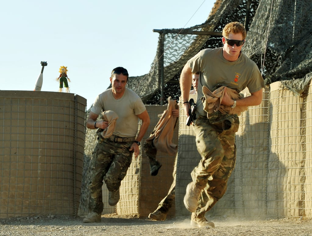 Prince Harry and a fellow pilot ran around the base.