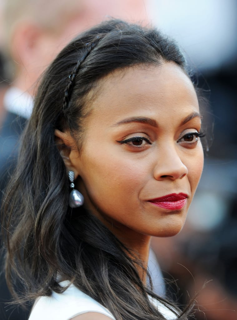"""Zoe Saldana's """"headband,"""" which she donned at the Cannes Film Festival, was a petite braid formed from her own hair."""