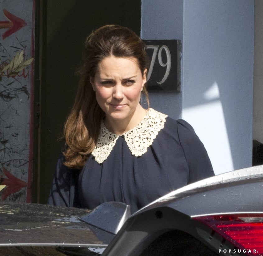 Kate Middleton wore a navy blouse with a white collar.