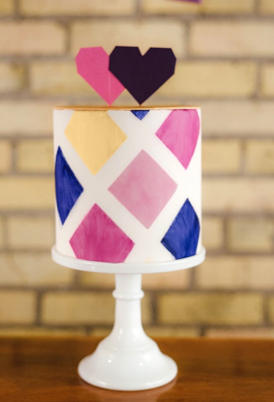 The bold pattern of this fun cake is made even sweeter topped with pixel-like hearts.   Photo by Jeff Loves Jessica via 100 Layer Cake