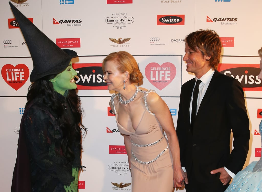 Nicole Kidman and Keith Urban laughed with Jemma Rix, who plays Elphaba in Australia's staging of Wicked, on Friday at the Celebrate Life Ball in Melbourne, Australia.