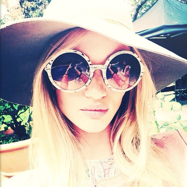 Rosie Huntington-Whiteley shaded her face from the sun in style. Source: Instagram user rosiehw