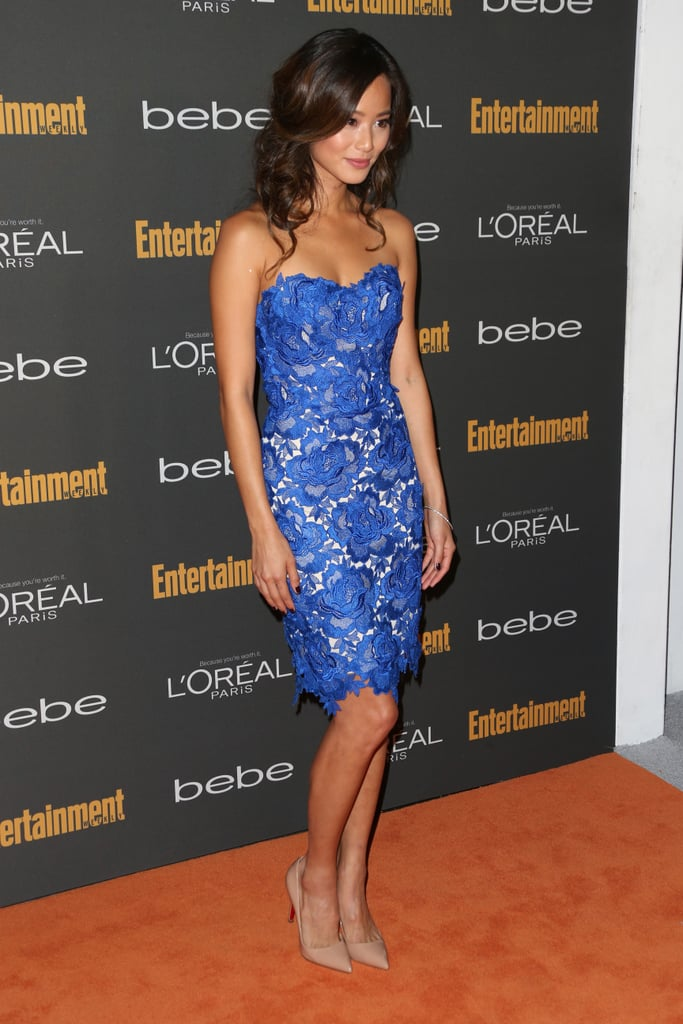 Jamie Chung chose a blue strapless floral appliqué dress and nude pointy pumps for the pre-Emmys festivities.