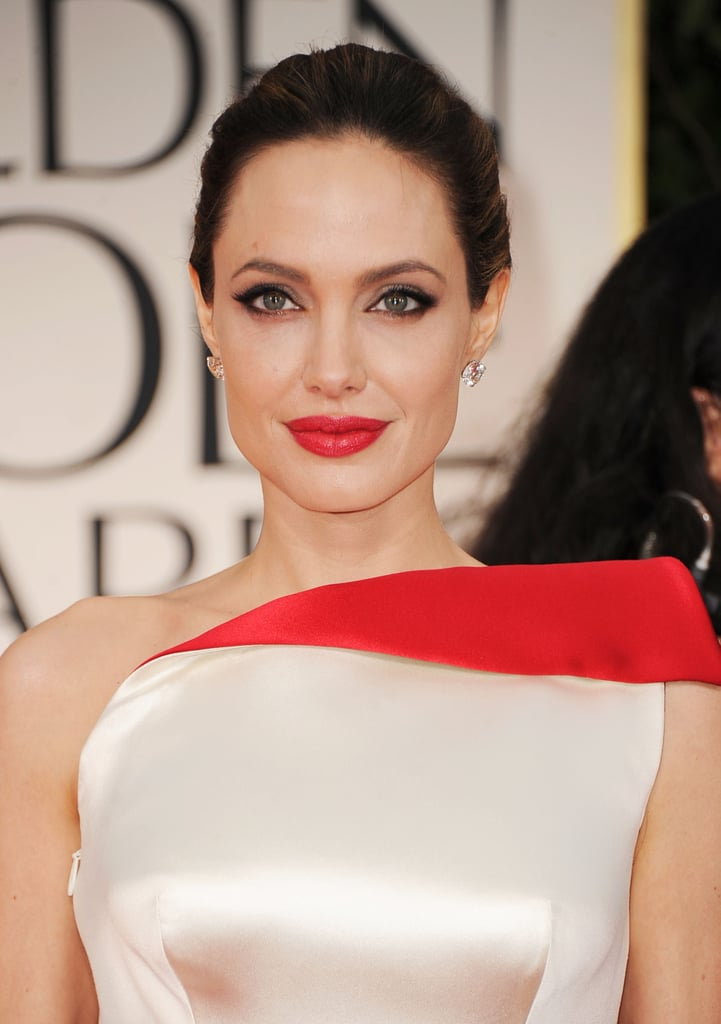 Angelina Jolie matched her red lips to the red in her Versace dress.