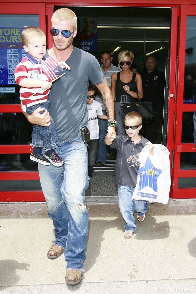 """The Beckhams visited an LA Toys""""R""""Us in July 2007 and left with a bag full of goodies."""