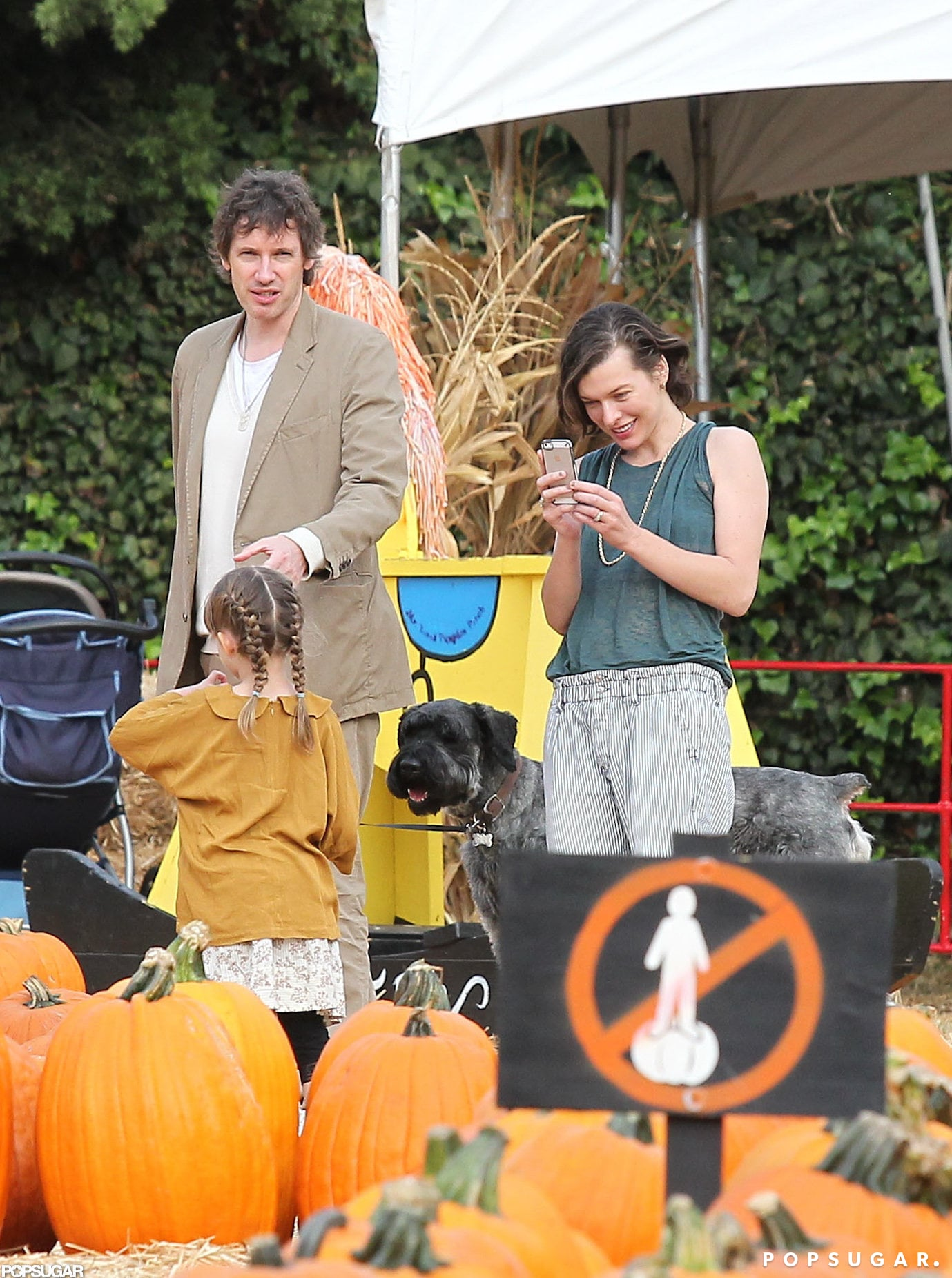 Milla Jovovich and her husband, Paul W.S. Anderson, checked out an LA patch with daughter Ever.