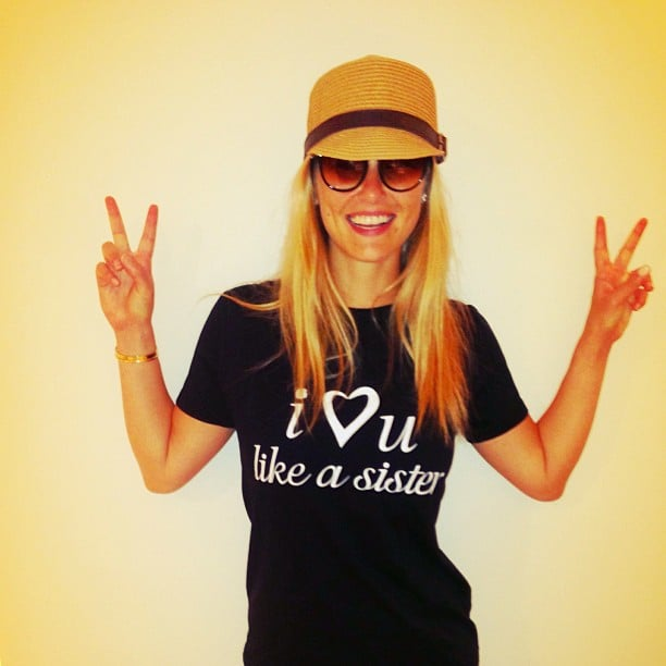 Bar Refaeli flashed double peace signs in a sweet t-shirt and raffia hat. Source: Instagram user barrefaeli