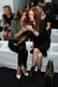 Carine Roitfeld and Julianne Moore shared a moment (and an iPhone) preshow at Reed Krakoff at New York Fashion Week. Note Carine's amazing white pumps.