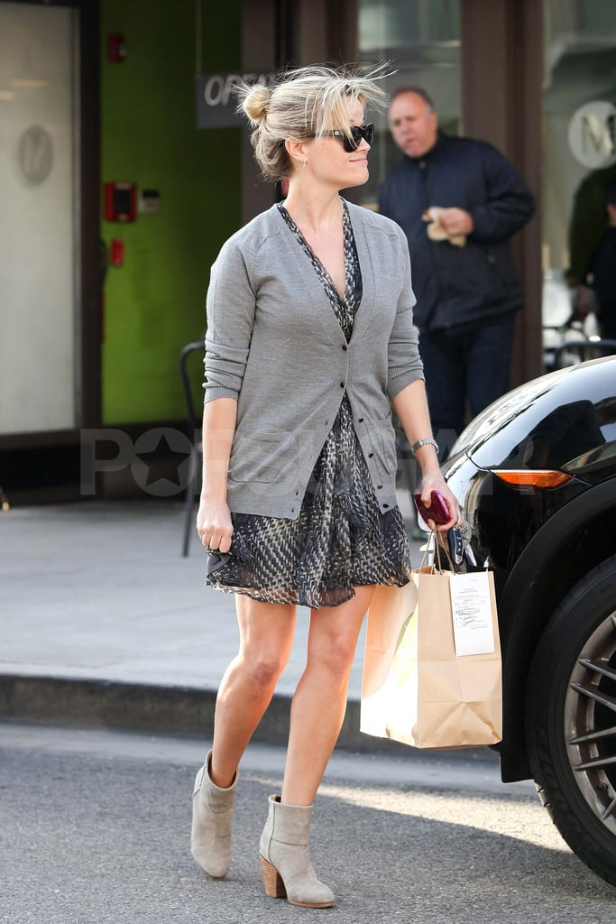 Reese Witherspoon wearing a gray cardigan.