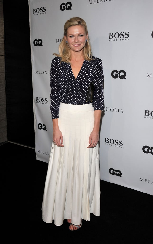 This is one of our favorite Kirsten fashion moments. The actress attended the 2011 Toronto Film Festival premiere of Melancholia in a cool navy and white polka-dot-printed Prada blouse and long pleated Chanel cream skirt combo. It's a fun play on sophisticated pieces.