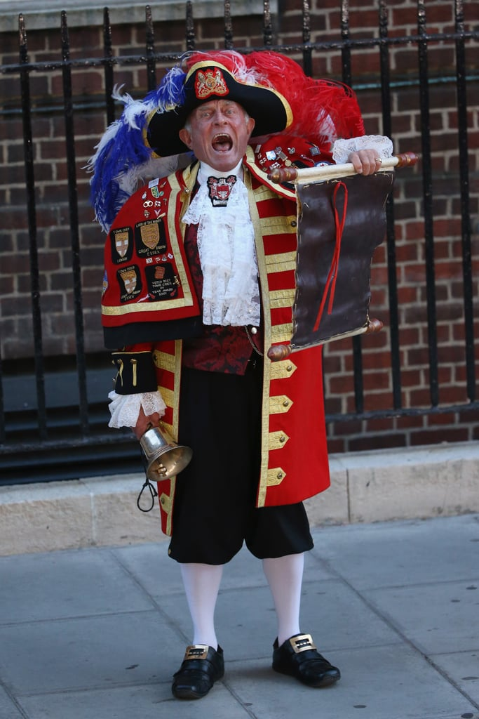 """A """"town crier"""" announced the news outside the hospital."""