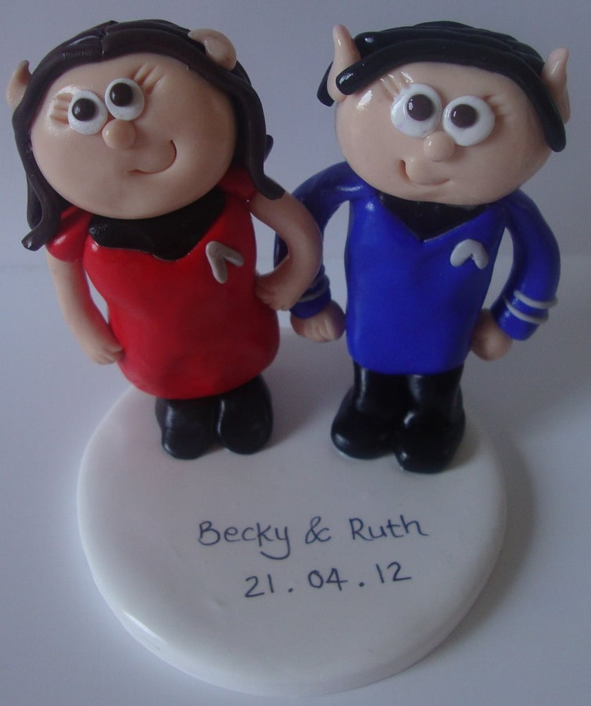 This personalized Star Trek topper ($65) features two bright-eyed cartoon figurines with an inscription of the couple's names and wedding date.