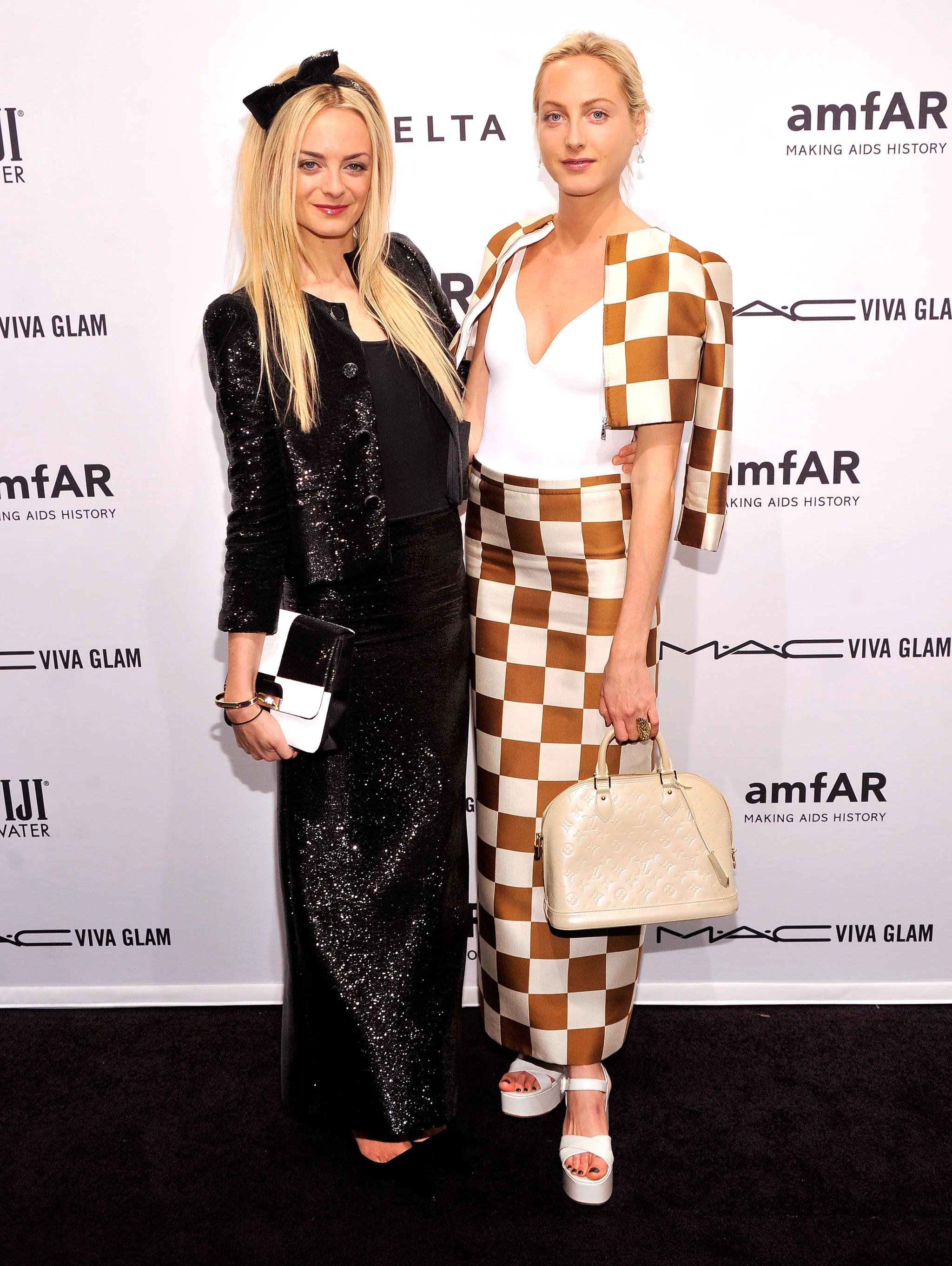 Virginie Courtin-Clarins and Claire Courtin-Clarins were arm in arm at the amfAR New York Gala.