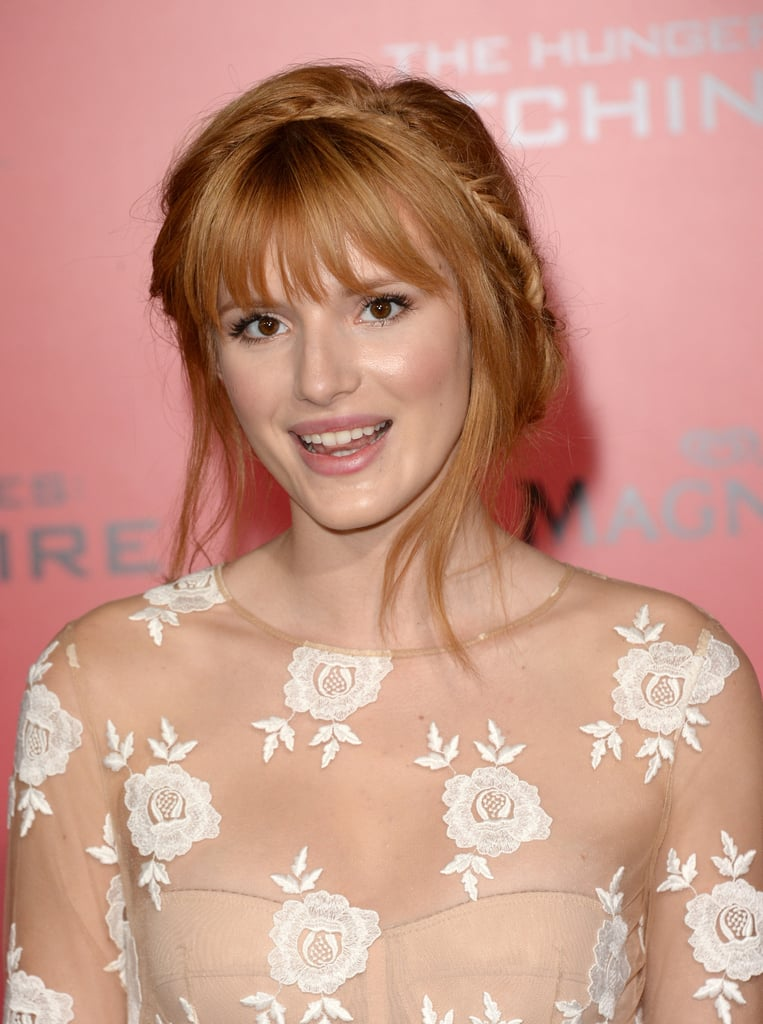 Bella Thorne was one of the new faces to hit the Hunger Games red carpet in LA. She wore a series of pink shades on her face and had her hair swept up into a twisted style.