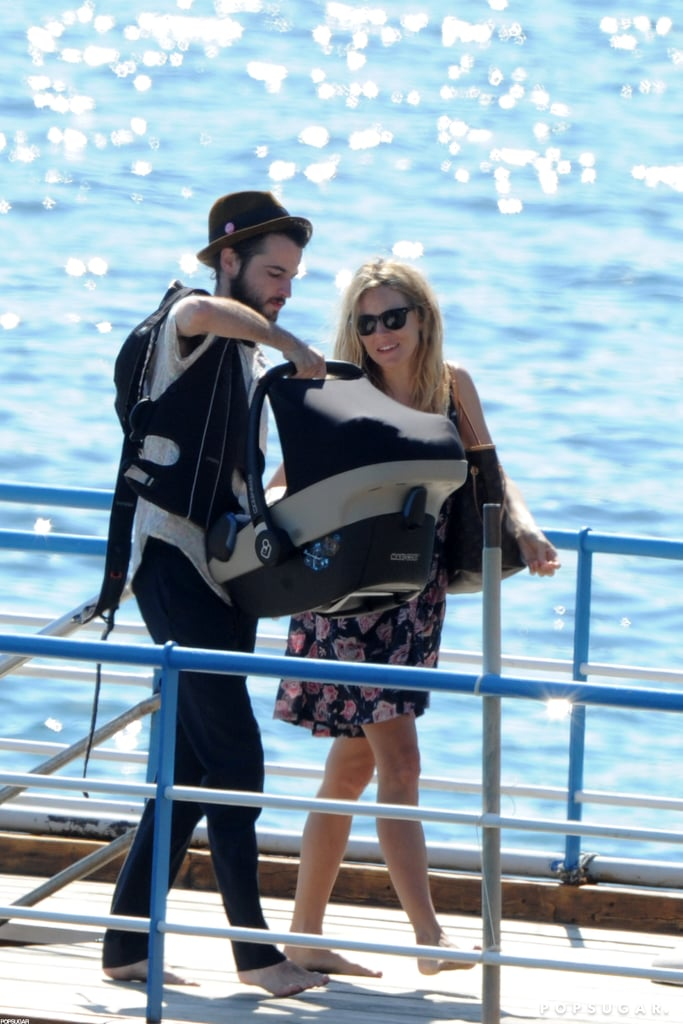 Sienna Miller and Tom Sturridge brought baby Marlowe along on a getaway to Positano.